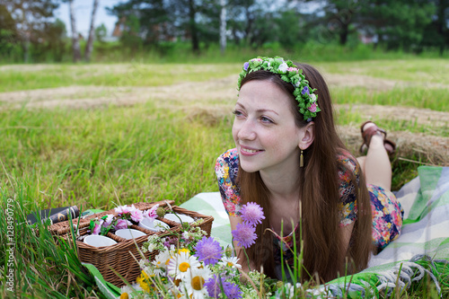 Poster Girl lying on meadow