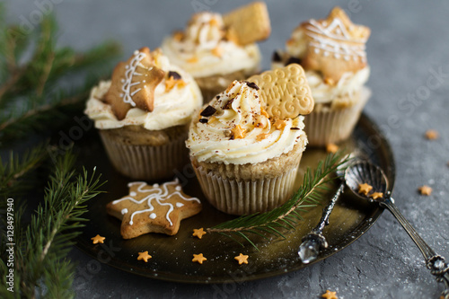 Poster Cupcakes, adorned with Christmas decorations on a gray background