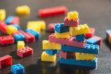 Plastic blocks on table. - 128501730