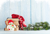 Christmas fir tree, books and snowman