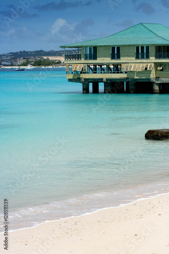 Fotobehang Overige House on turquiose sea in Barbados