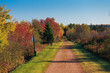 Fall foliage along the Trans Canada Trail or known locally as the Confederation Trail in rural Prince Edward Island, Canada
