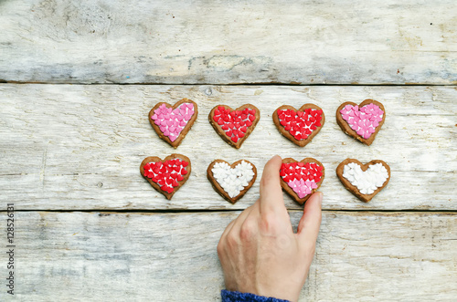 Poster Male hands holding cookie in the forms of heart