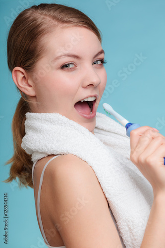 Poster Girl singing using toothbrush.