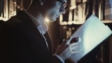 A young man with a flashlight at night looking documents in libraries