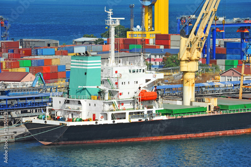 Juliste Bulk cargo ship under port crane