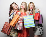 Portrait of young happy smiling women with shopping bags