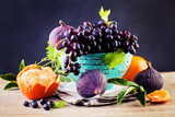 Fruit Background with Grape, Orange, Figs on Blackboard Backgrou