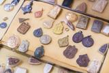 Bangkok, Thailand - famous amulet market with stone and metal Buddhist talismans