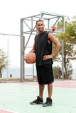 African basketball player standing in the street