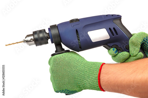 Plakat Hammer drill or screwdriver in hand on white