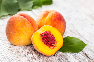 Fresh peaches on wood background.