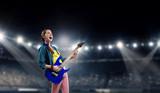 Rock musician at concert . Mixed media