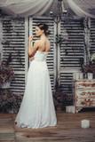 Young bride posing in wedding dress