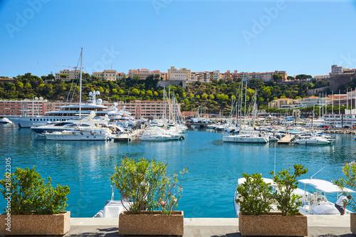 Aluminium Monaco, Monte-Carlo, Monaco Ville, 8 August 2016: Port Hercules, the preparation of the yacht show MYS, sunny day, many yachts and boats, RIVA, Prince's Palace of Monaco, megayachts, Massif of houses