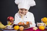 funny boy chef prepares a fruit cake