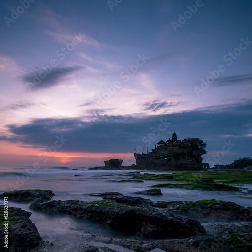 Fotobehang Purper BALI Landmark Tanah Lot temple in sunset. Bali island, indonesia