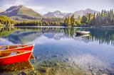 Read boat on summer morning lake in High Tatras Slovakia. Original wallpaper from nature