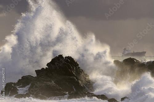 Sea storm at sunset