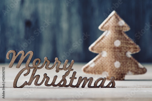 Poster text merry christmas and christmas tree