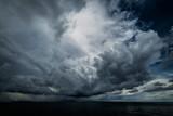 Dark clouds in open ocean - 128660570