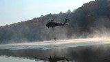 Black hawk helicopter picking up water