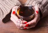 Tea in woman hand