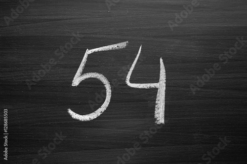 Poster number fifty four enumeration written with a chalk on the blackboard