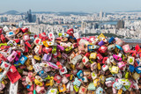 colourful love locks at Seoul Tower with Seoul skyline in background