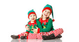 Christmas concept two children cheerful elf looking upisolated