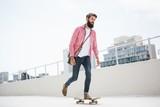 Hipster man doing skateboard