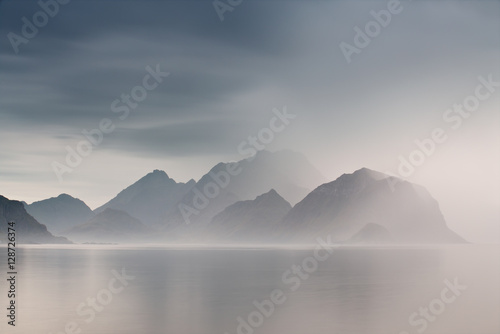 Poster Summer cloudy Lofoten islands. Norway misty fjords.