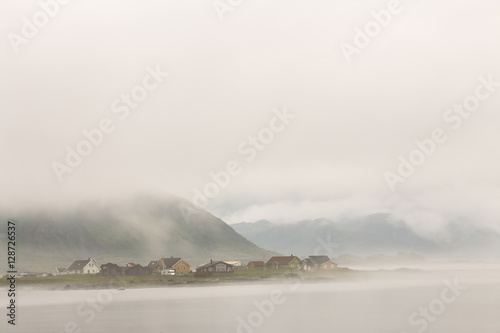 Norway village in clouds of fog. Cloudy Nordic day. - 128726537