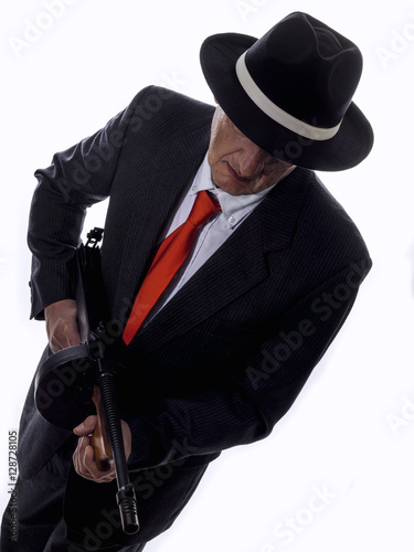 Old style gangster with tommy gun, on white background Poster