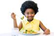 Little black girl eating healthy vegetable meal.
