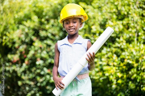 Poster Cute mixed-race girl wearing handyman clothes