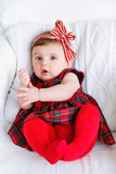 Beautiful baby wearing red headband bow top view