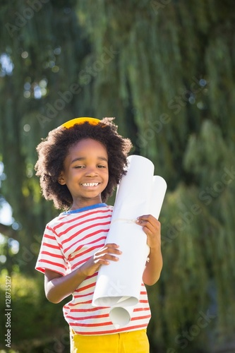 Poster Smiling boy holding plan