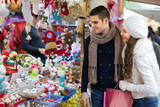 Young man with girlfriend at  X-mas market