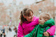 mother and little son travel in European city