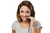 attractive young woman with headset on her head