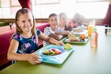 Children eating at the canteen  - 128756707