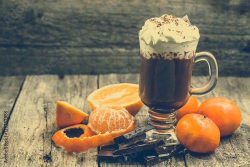 Foto op Canvas Chocolade Hot chocolate with whipped cream, cup of sweet dessert