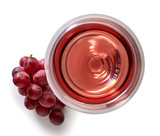 Glass of rose wine and grapes - 128769539
