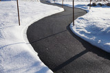 winding sidewalk after snow with snow removed - 128824578