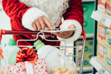 Santa using a tablet at the supermarket
