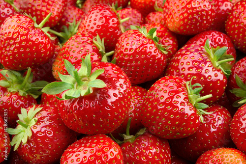 Strawberry. Fresh organic berries macro. Fruit background - 128862325