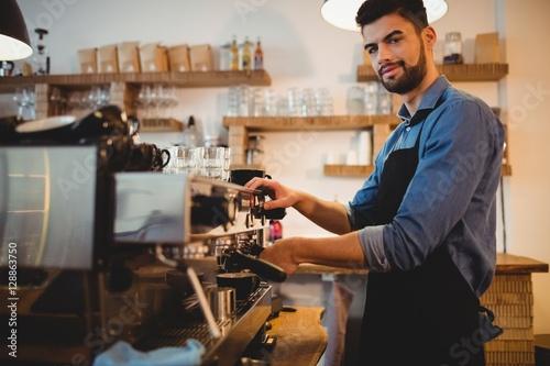 Poster Man taking coffee from espresso machine