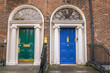 Green and blue doors in Dublin - 128865928