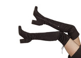 Woman legs in black suede boots on white background - 128869128
